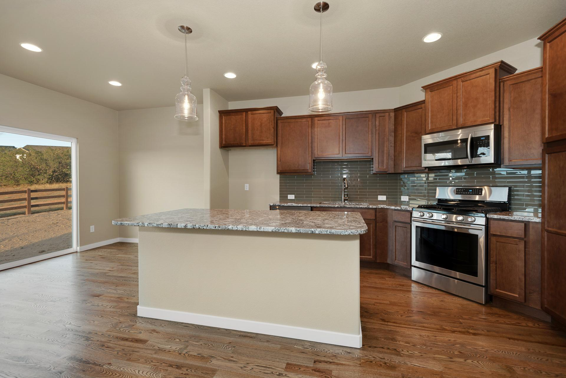 Kitchen featured in the Appaloosa II By Vantage Homes in Colorado Springs, CO