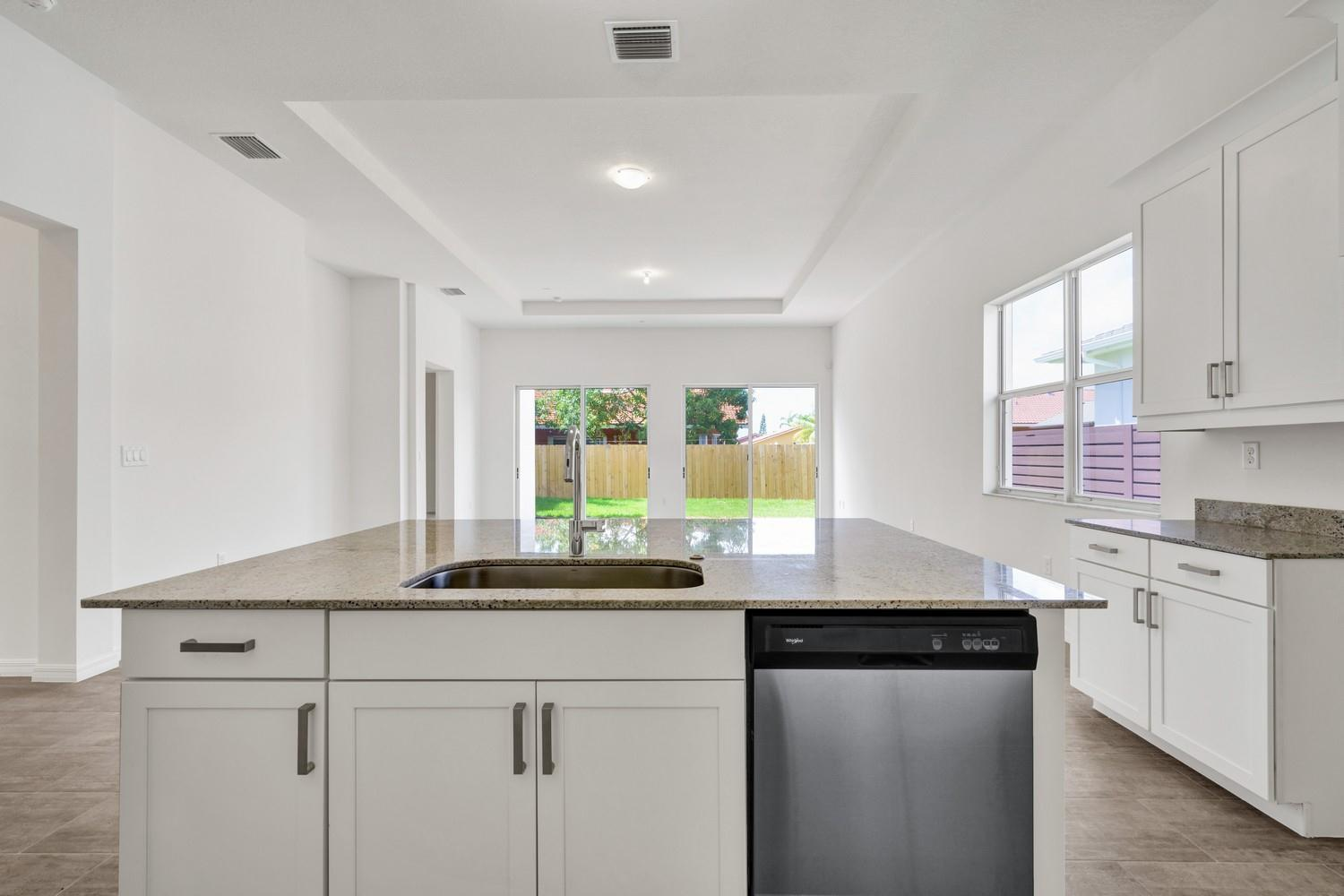 Kitchen featured in the Aria 10XL By Luxcom Builders in Miami-Dade County, FL