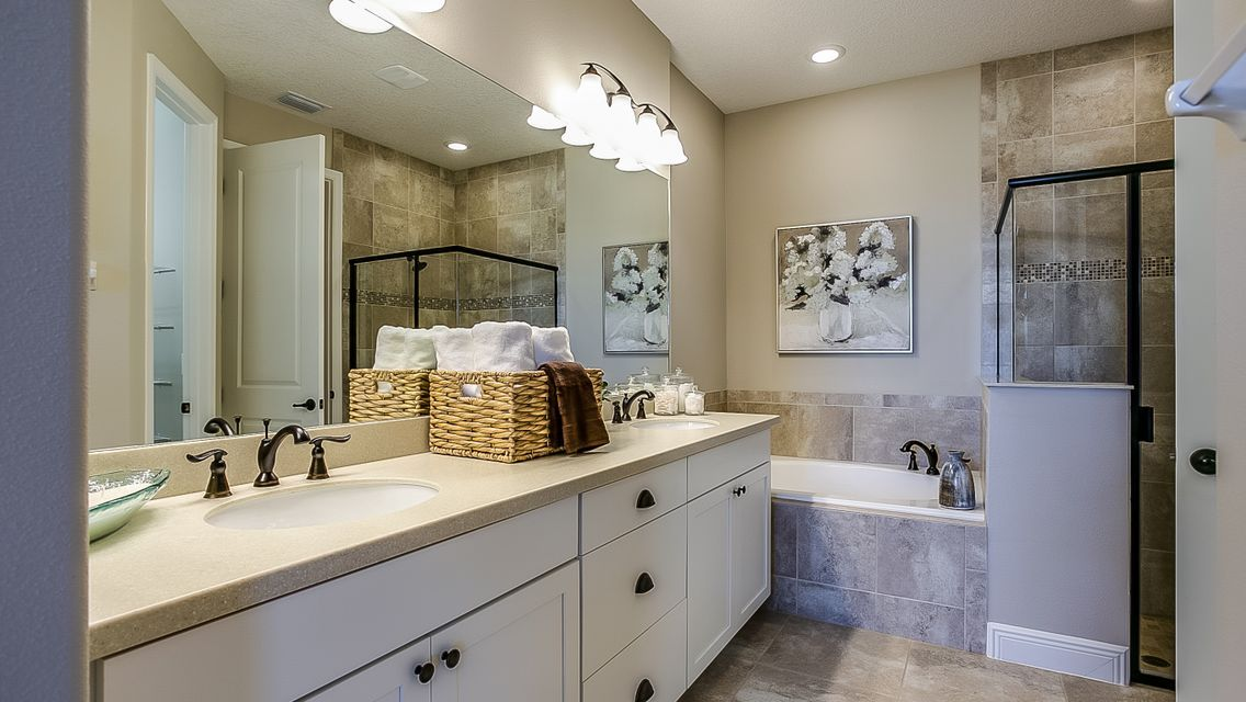 Bathroom featured in the Lindsey By Viera Builders  in Melbourne, FL