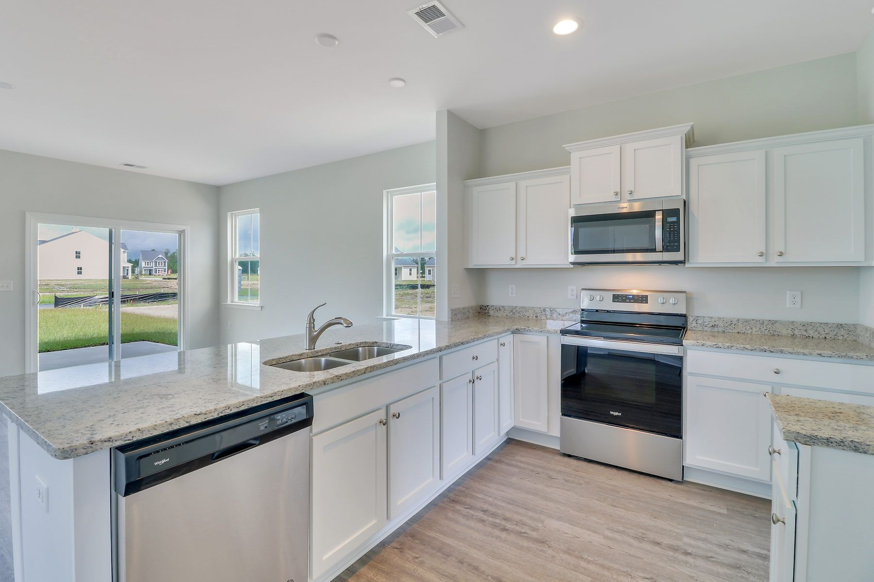 Kitchen featured in The Malind By Village Park Homes in Hilton Head, SC