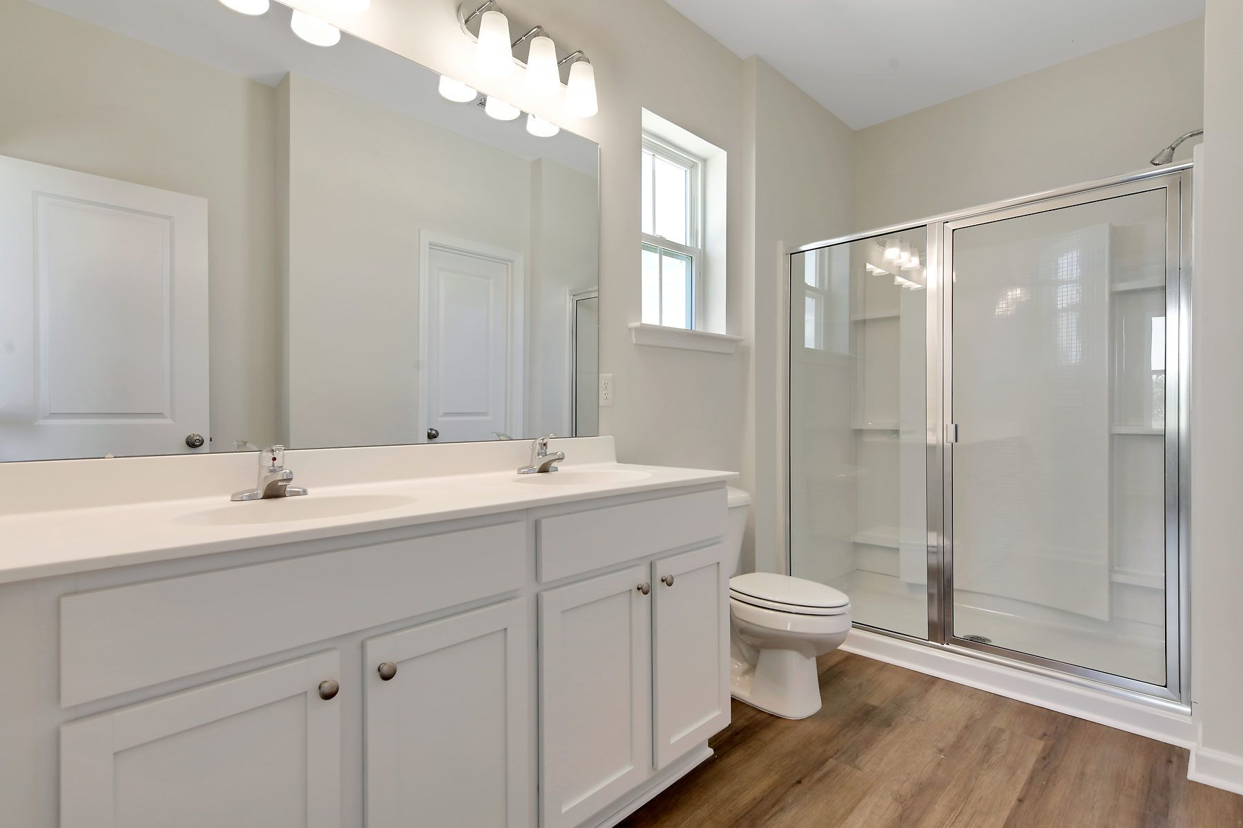 Bathroom featured in The Ridgeland By Village Park Homes in Hilton Head, SC