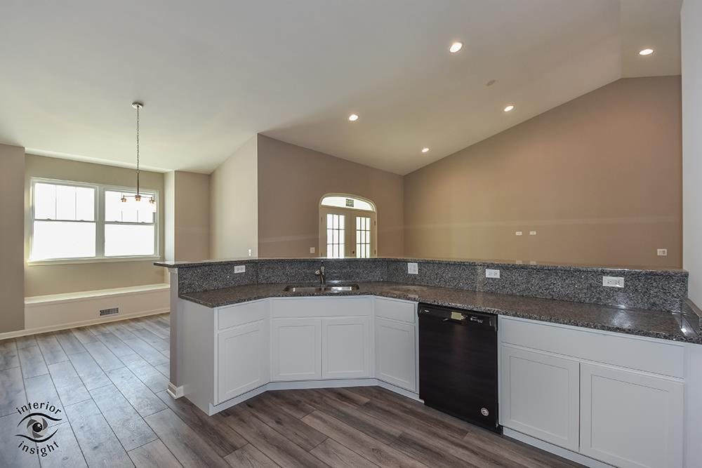 Kitchen featured in the Cedarcrest By West Point Builders in Chicago, IL