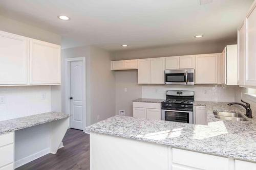 Kitchen-in-The Ridgeport-at-Oak Park-in-Youngsville