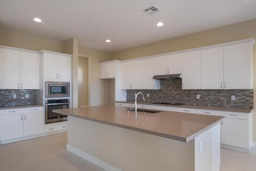Kitchen-in-Topaz Plan 8-at-Ovation at Mountain Falls-in-Pahrump