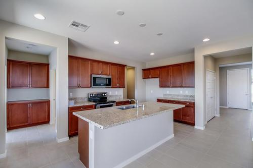 Kitchen-in-Onyx Plan 2-at-Ovation at Mountain Falls-in-Pahrump