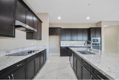 Kitchen-in-Topaz Plan 7-at-Ovation at Mountain Falls-in-Pahrump