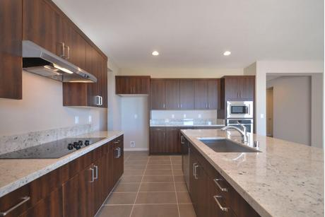 Kitchen-in-Jade Plan 5-at-Ovation at Mountain Falls-in-Pahrump