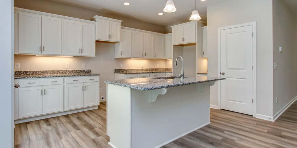 Kitchen featured in the Pembroke III By Windsor Homes in Wilmington, NC