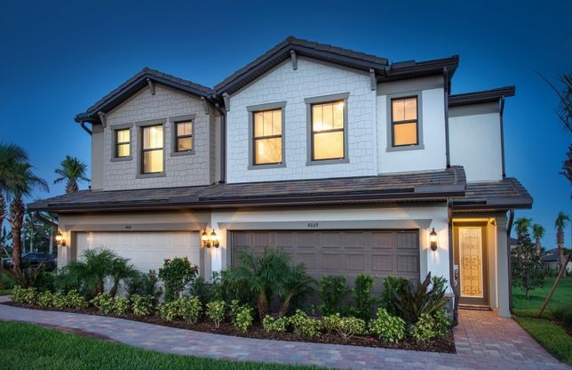 Leland:The Leland, a two-story town home with a 2 car garage, shown as the model Exterior at The Fields