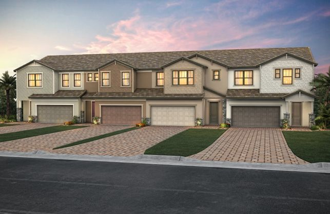 Exterior:The Raritan, a two-story town home with a 2 car garage, shown with Home Exterior C2A-B 4-unit