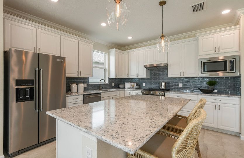 Kitchen featured in the Prosperity By DiVosta Homes in Indian River County, FL