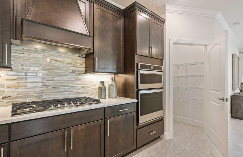 Kitchen featured in the Mystique By DiVosta Homes in Indian River County, FL