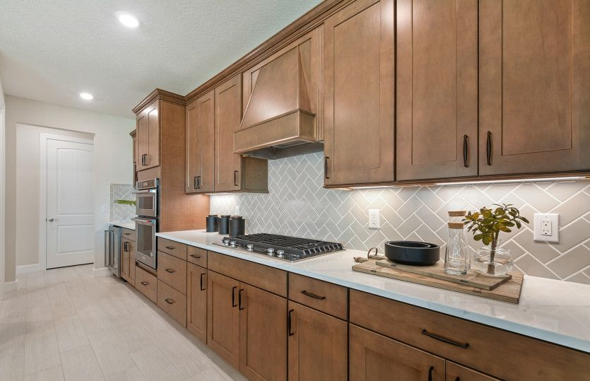 Kitchen featured in the Renown By DiVosta Homes in Indian River County, FL