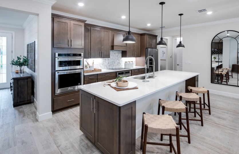 Kitchen featured in the Stardom By DiVosta Homes in Indian River County, FL