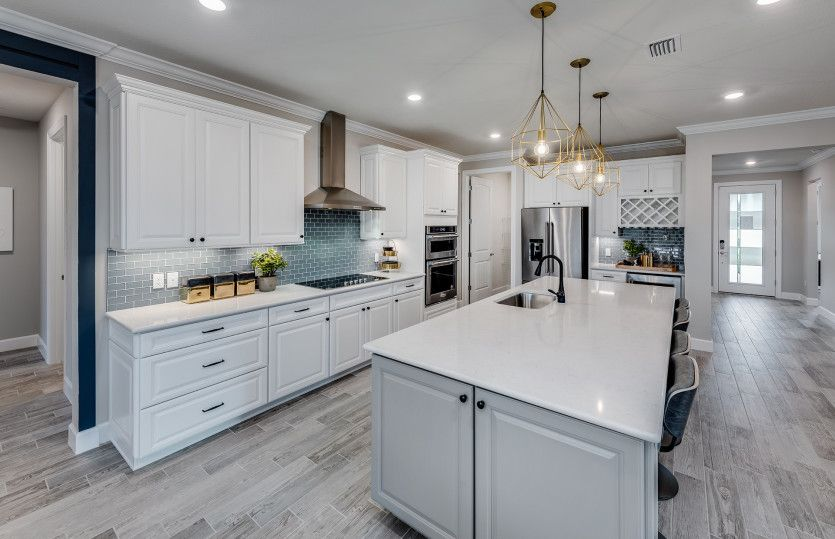 Kitchen featured in the Reverence By DiVosta Homes in Indian River County, FL
