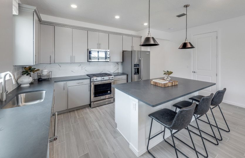 Kitchen featured in the Highgate By DiVosta Homes in Martin-St. Lucie-Okeechobee Counties, FL