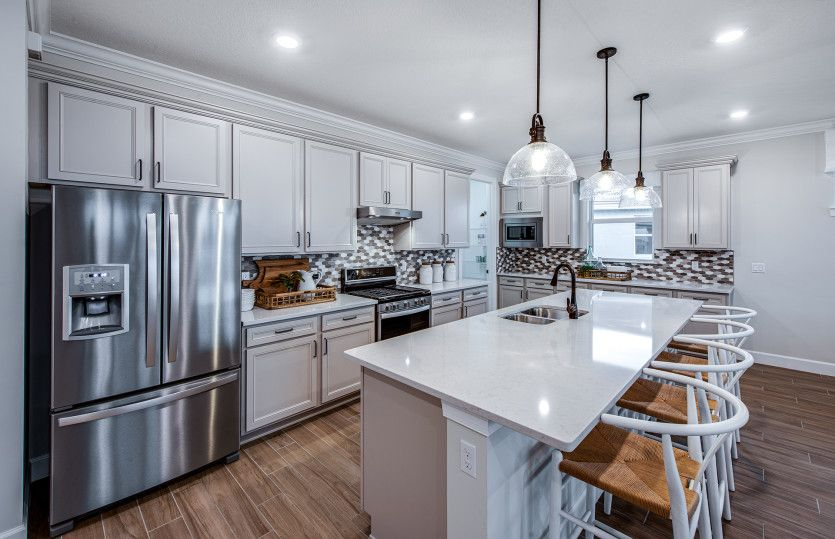 Kitchen featured in the Palmary By DiVosta Homes in Palm Beach County, FL