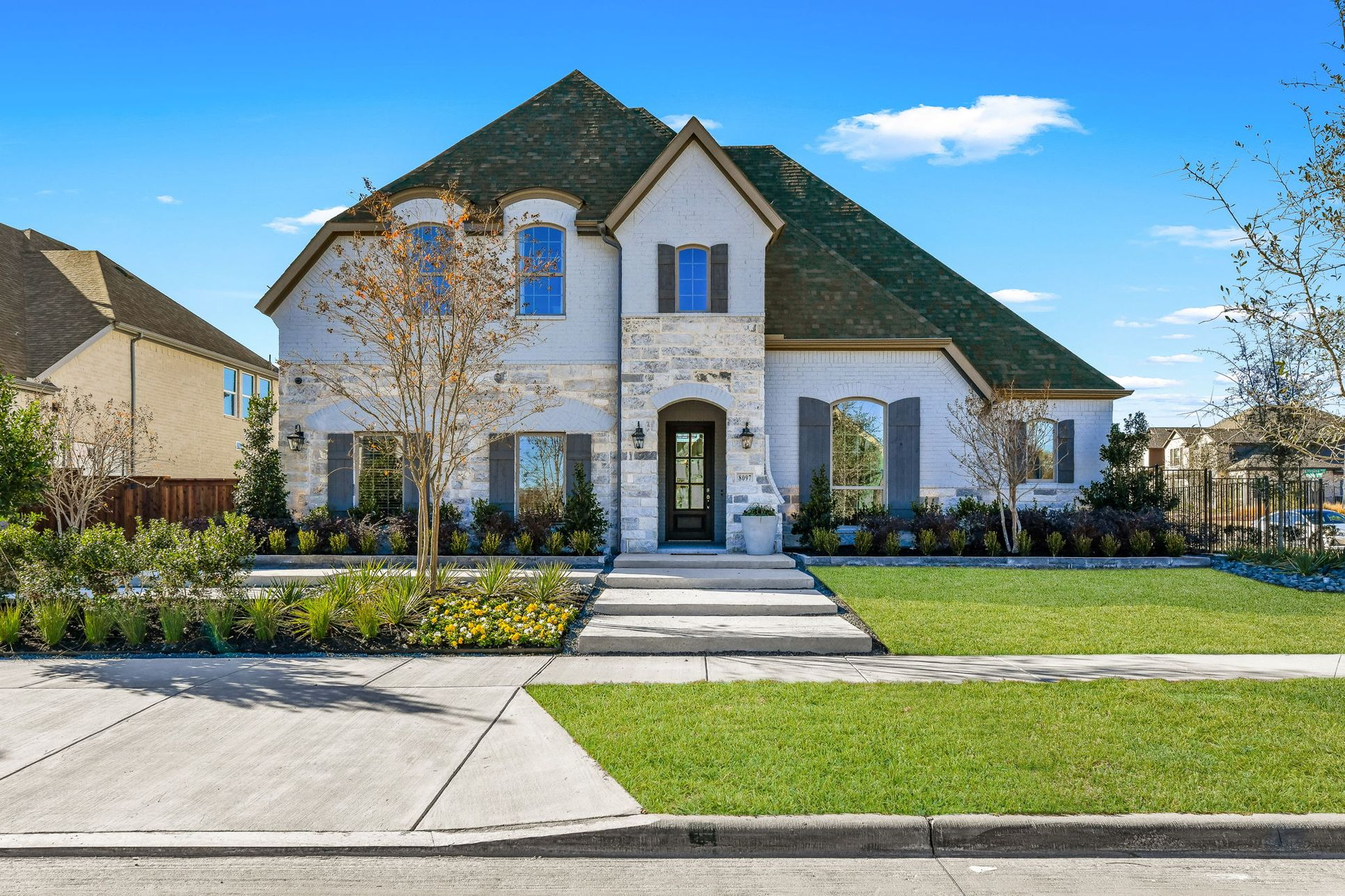 Plan 1632 Front Elevation Representative Photo by American Legend Homes