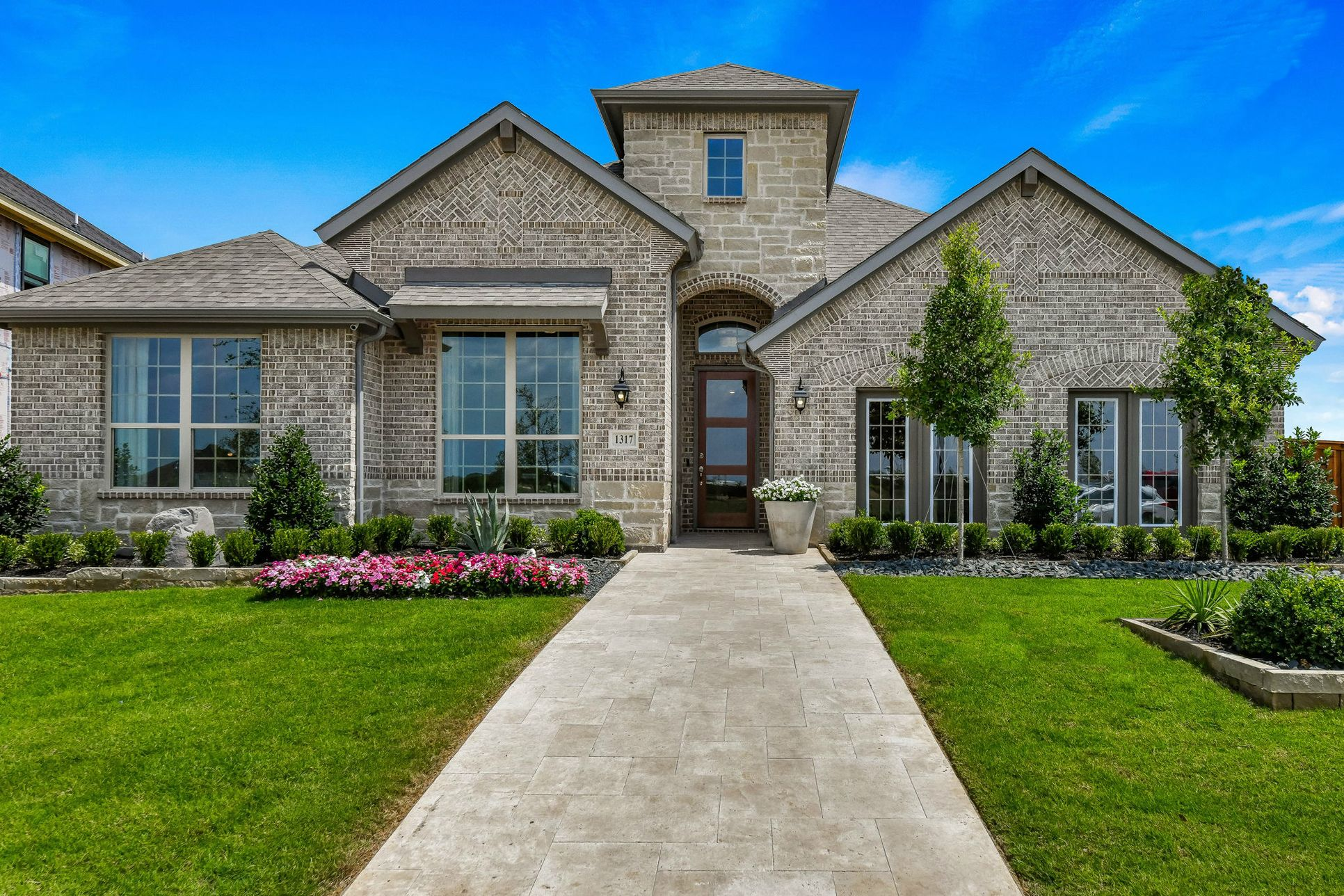 Plan 1685 Front Elevation Representative Photo by American Legend Homes