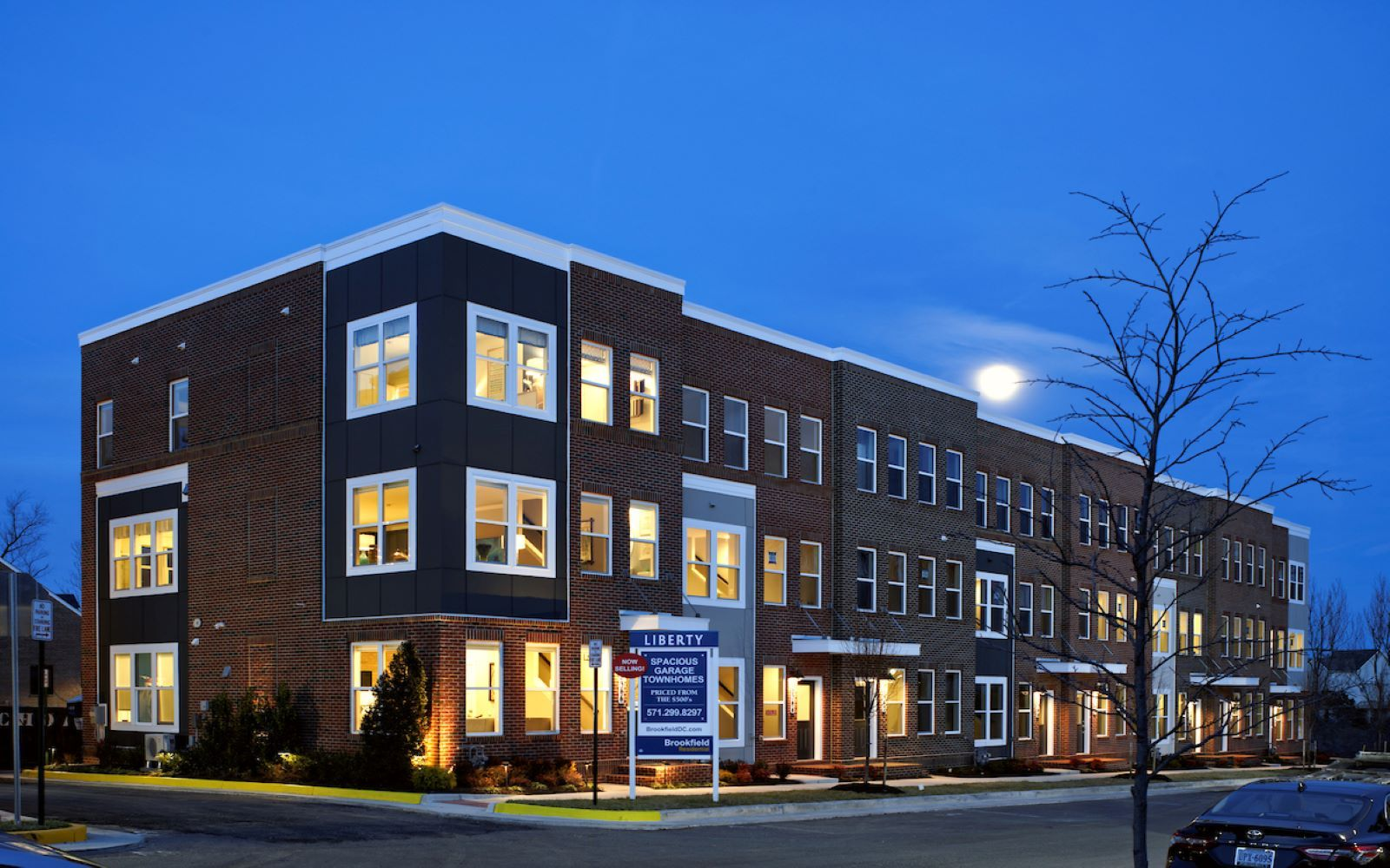 Exterior:An evening view of a row of homes by Brookfield Residential at Liberty in Lorton VA