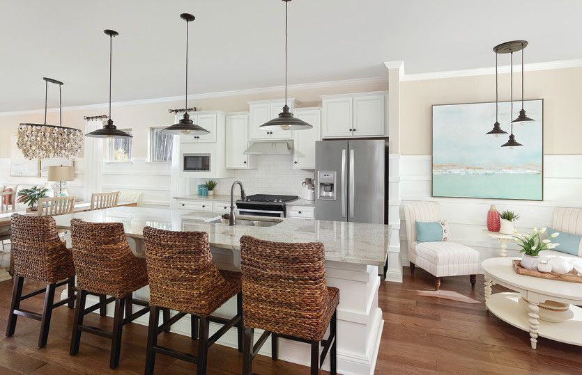 Steel Creek:Open kitchen with large center island, tile backsplash, stainless gas appliances & seating area to v