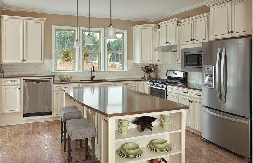Taft Street:Island kitchen with cream cabinets, subway tile backsplash, stainless appliances and quartz countert