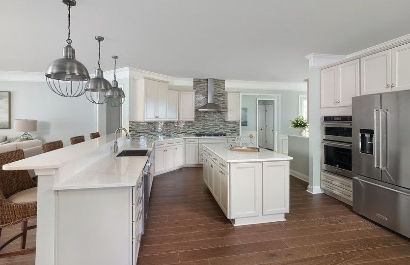 Sonoma Cove:Huge open gourmet kitchen with large center island, pendant lights, farmhouse sink, tile backsplash