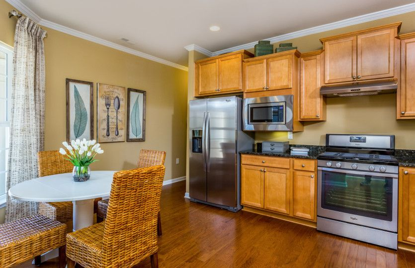 Noir Coast:Kitchen with your choice of granite or quartz countertops, overlooks the gathering room