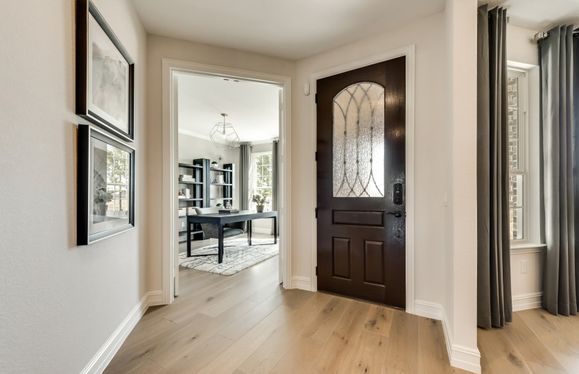 Exterior:Model Representation - Formal dining room adds drama and sophistication to your entryway