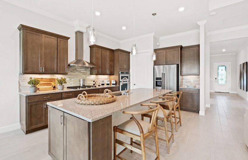 Prestige:Kitchen with Stainless Steel Appliances and Large Center Island
