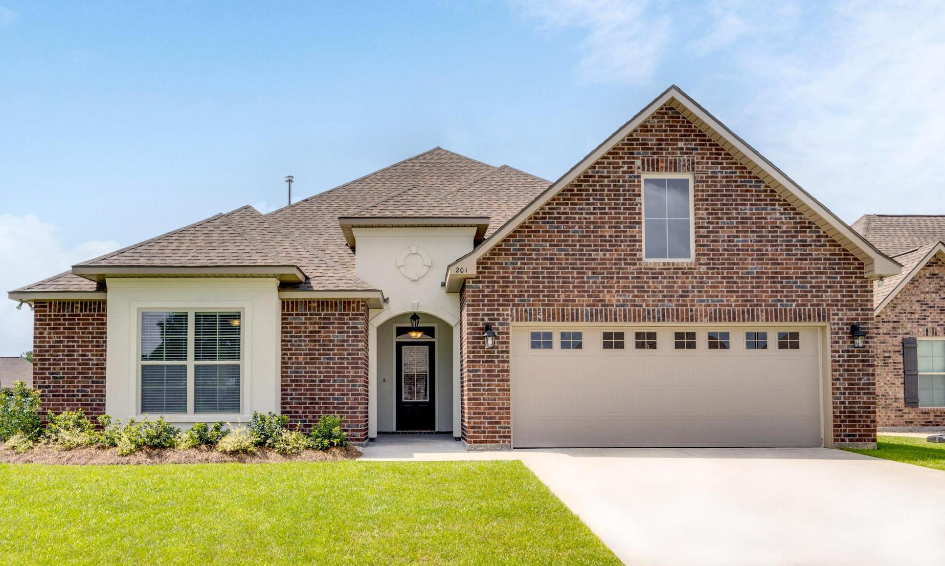 Front of Home- Brick- Stucco- arch- front loading garage- DSLD Homes- Lafayette area - Lafayette-...:Front of Home The Estates at Moss Bluff Model Home
