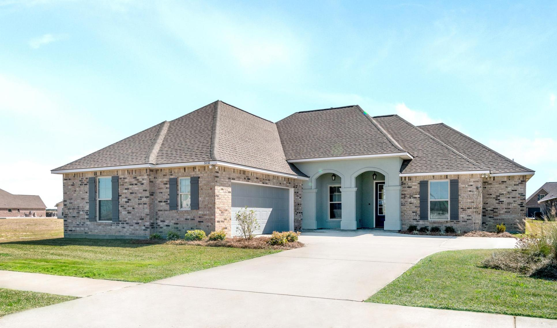 new construction homes in lake charles, la by dsld homes:The Cove at Morganfield - Model Home Exterior