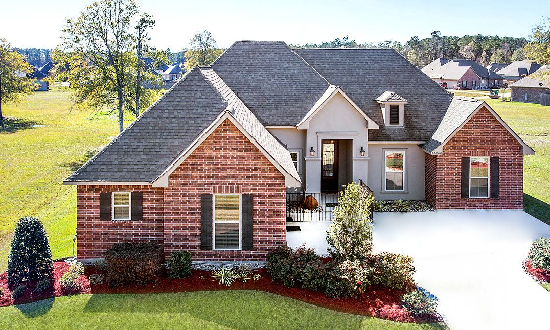Front of Model Home- Brick- Stucco- side loading garage- Hammond Area- DSLD Homes- Hammond- Louis...