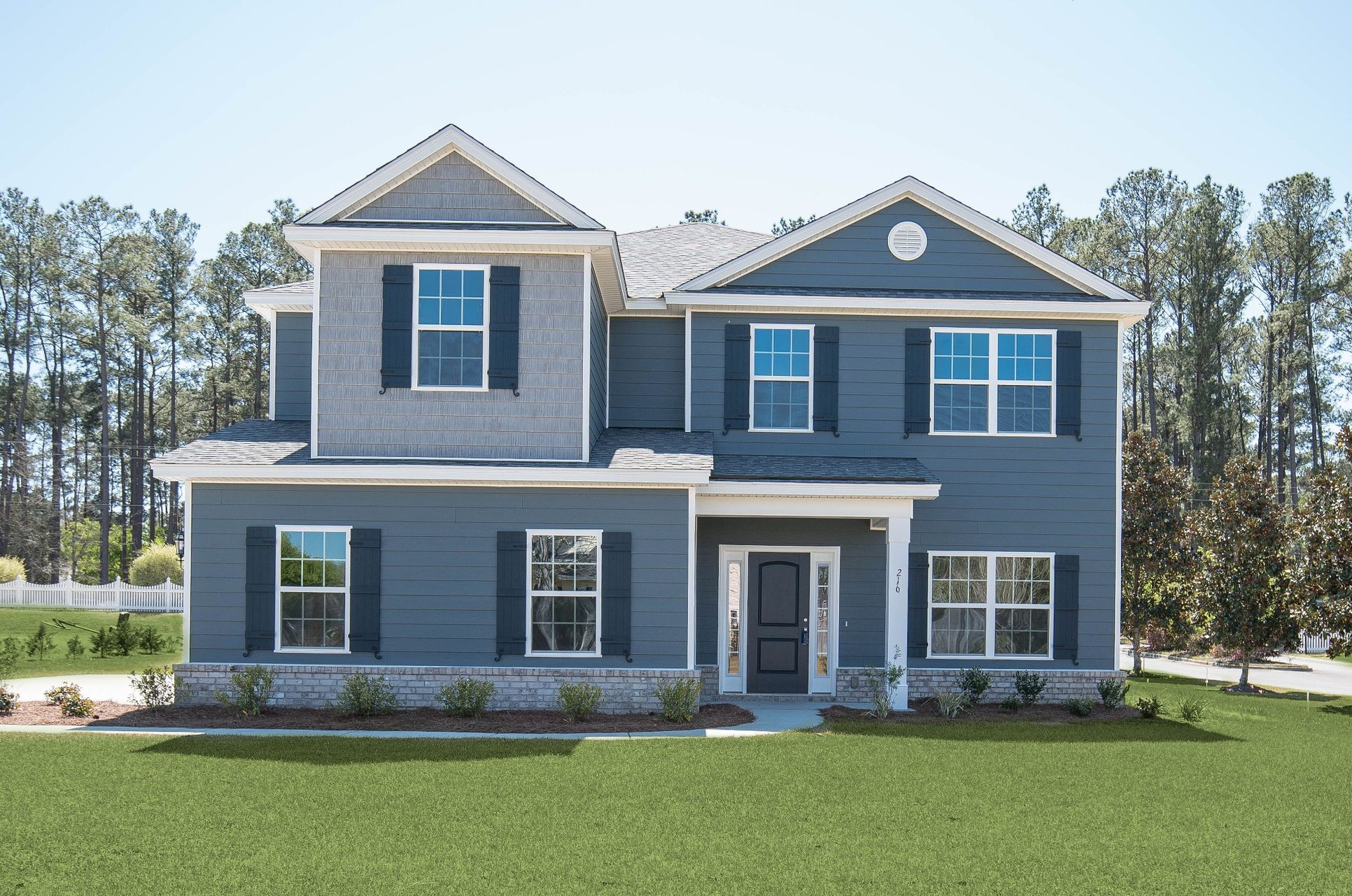 Elevation B with side entry garage and Hardieboard siding per community standards:Nantucket Signature