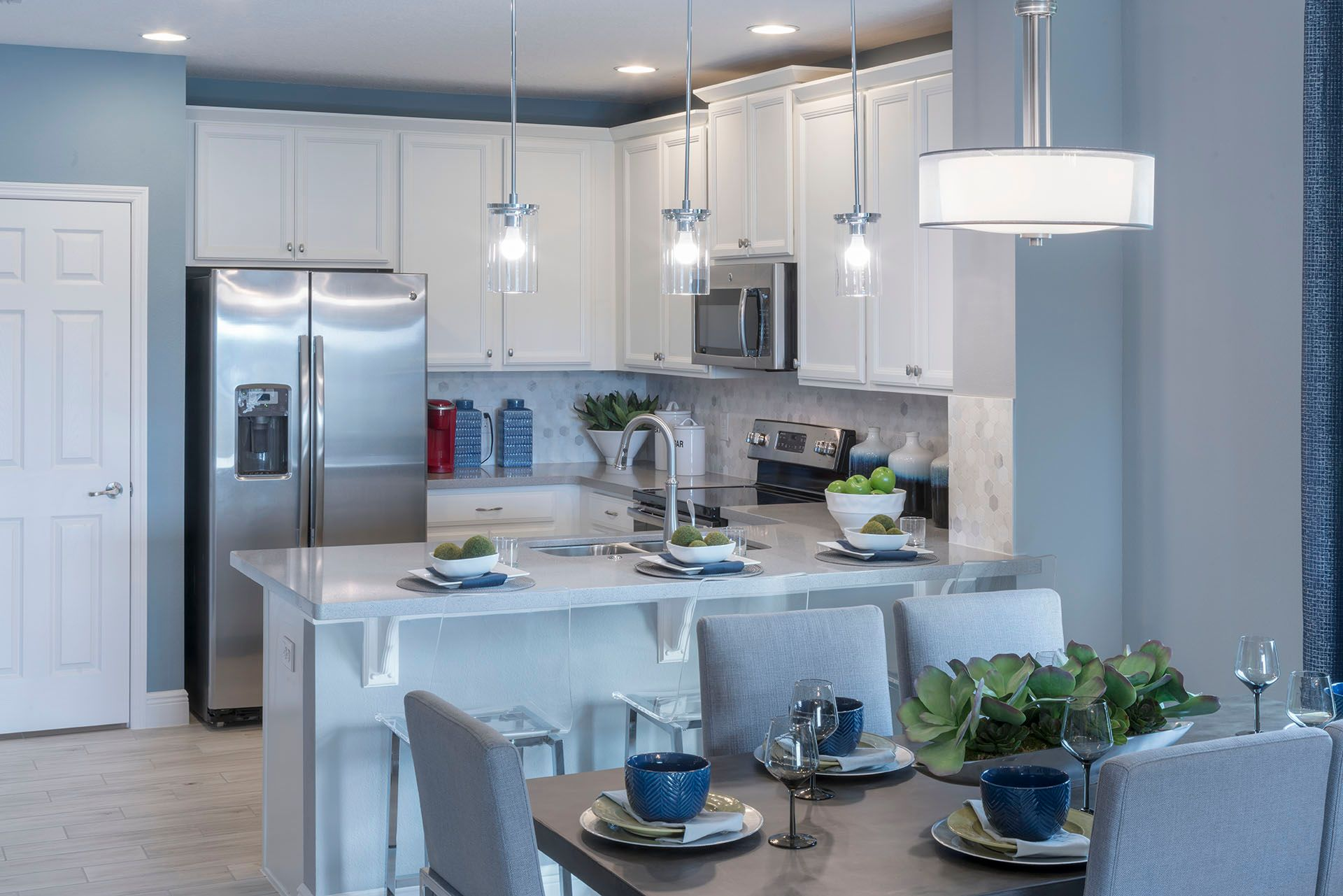 Overlook Reserve Lexington Model Home - Kitchen and Dining Area:Kissimmee, Florida New Home Community