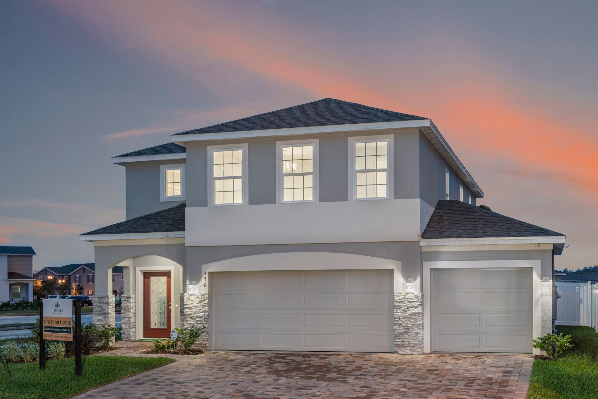 Elevation 1 with Stone:Sanibel Model Home in Williams Preserve
