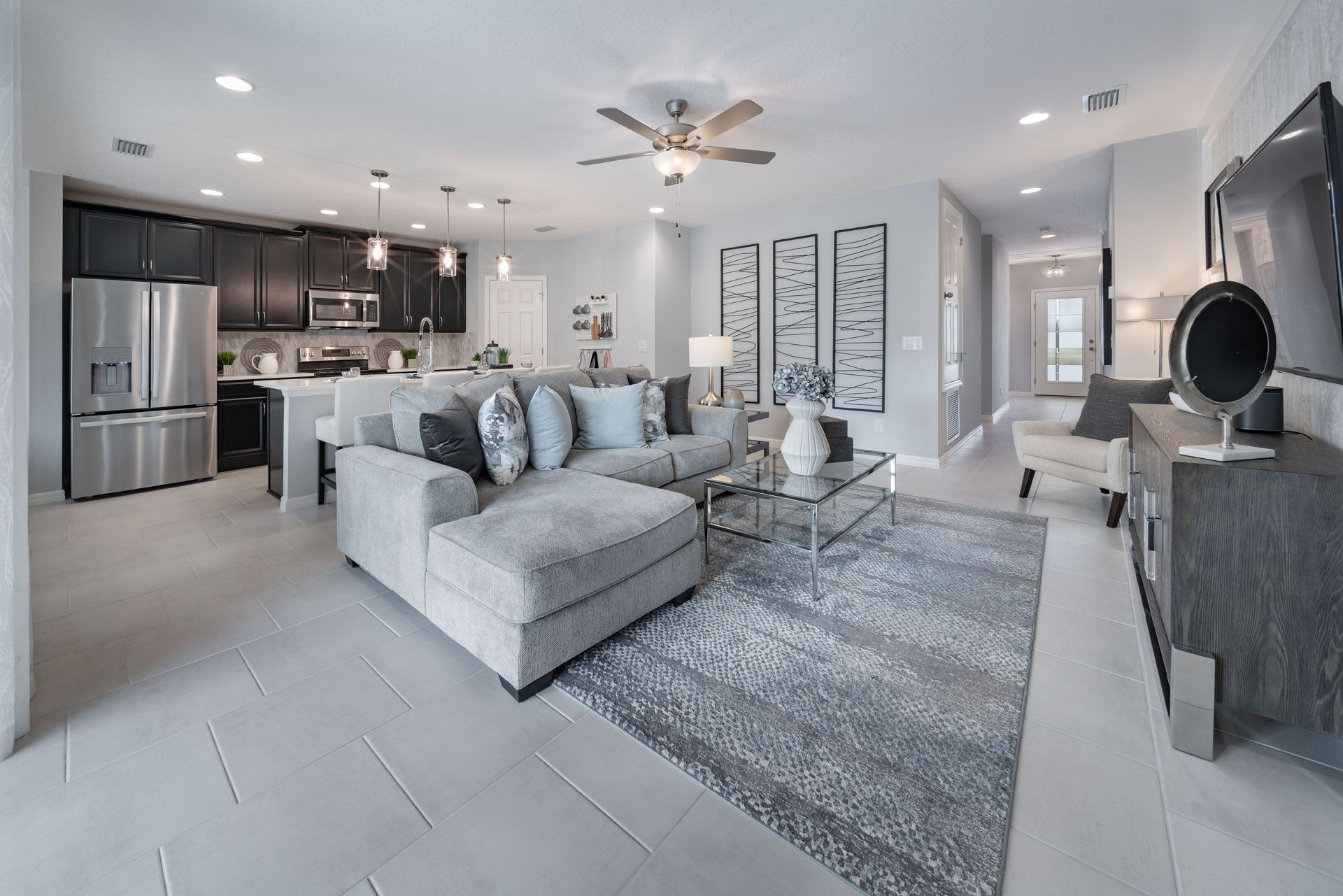 Entire Main Open Area:Selby Flex Model Home in Orchid Terrace, Haines City