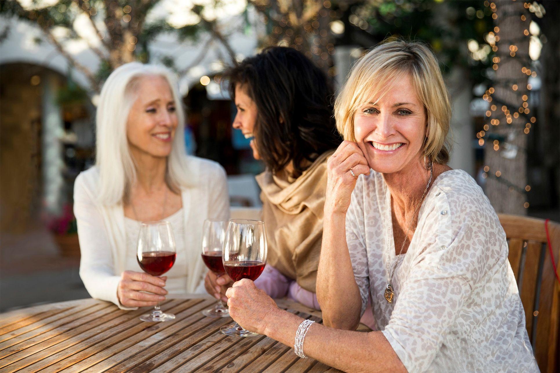 Older ladies enjoying wine