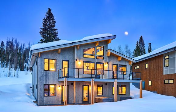Ramshorn II exterior:This gorgeous home features a generous two story deck/covered patio with options for glass railings