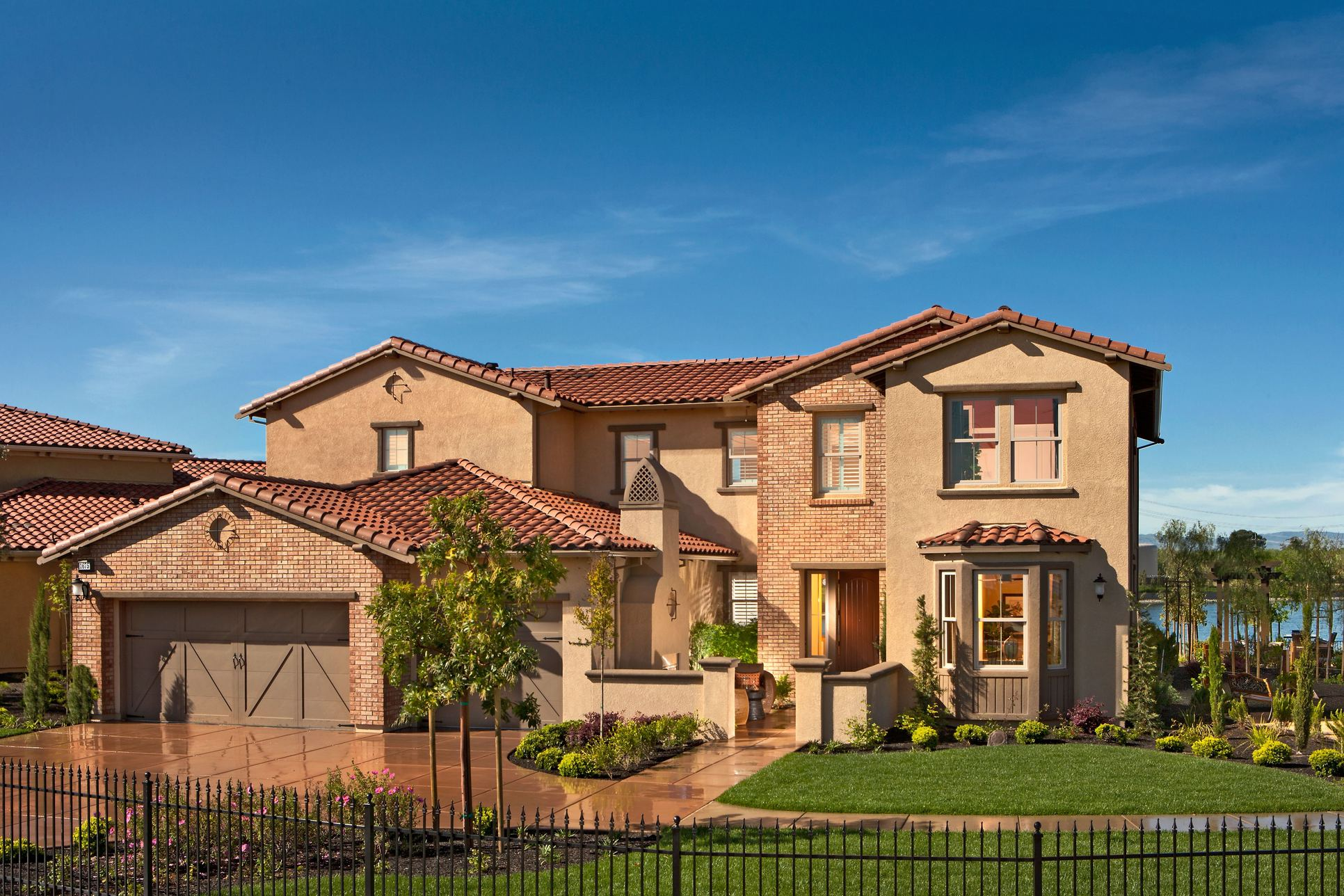 Bella Lago Plan 2X Front:Enhanced curb appeal with beautiful landscaping