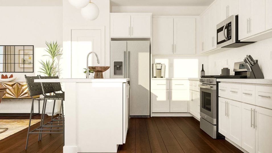 One Lake Creston Residence 2 Kitchen:Features of this kitchen include GE® stainless steel appliances and stylish Shaker-style cabinetry,