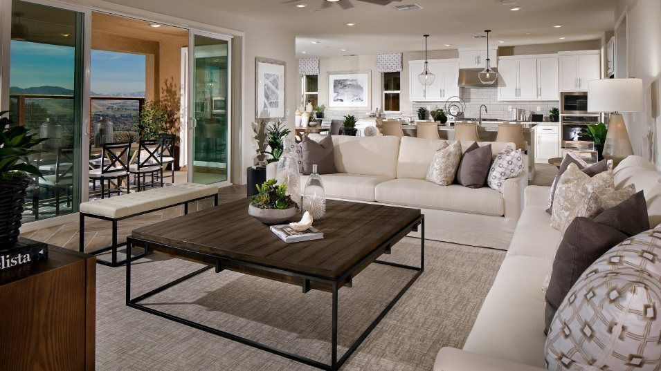 The Preserve Highlands Residence 1 Family Room:The spacious and wide open Family Room offers direct access to the covered patio outside, allowing f