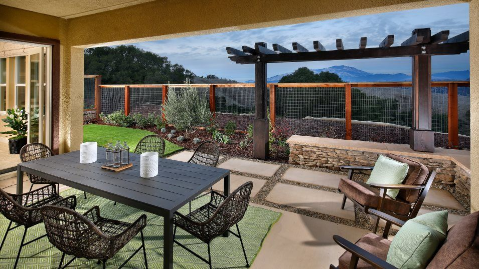 The Preserve Highlands Residence 1 Outdoor Space:A large covered patio off the Great Room is the perfect space for outdoor meals or gatherings and is