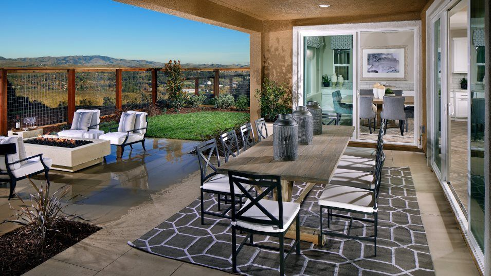 The Preserve Highlands Residence 2 Outdoor Space:With entryway through the dining nook or the Great Room, the covered patio is a great location for o