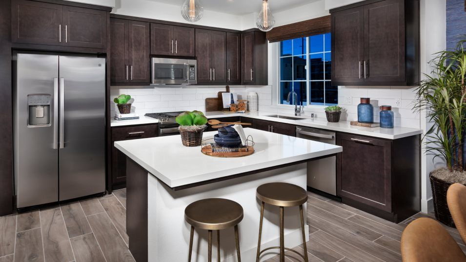 Bridgeway Towns Residence 1 Kitchen:The modern kitchen features stainless steel appliances, tons of cabinet space, a center island and l