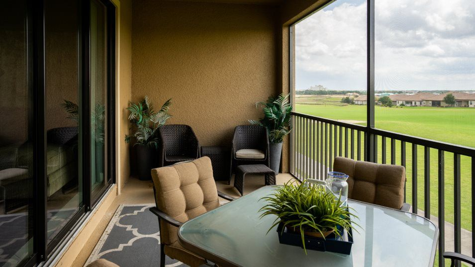 Championsgate Luxury Condo Turnberry Outdoor Space:Through sliding glass doors off the family room, the covered patio extends the home for more room to