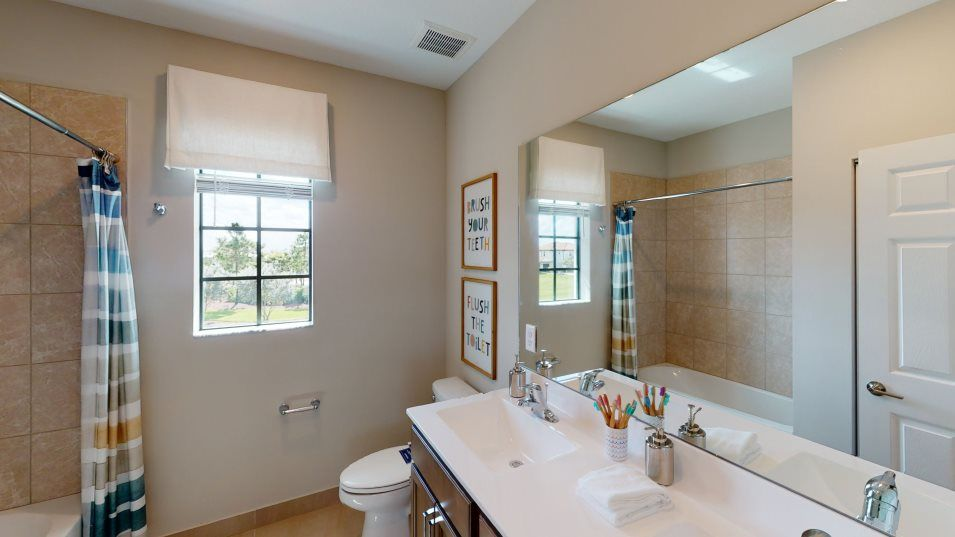 Arden The Arcadia Collection Lili Bathroom 3:A full bathroom upstairs o ers shared accessibility with dual sinks for extra convenience.