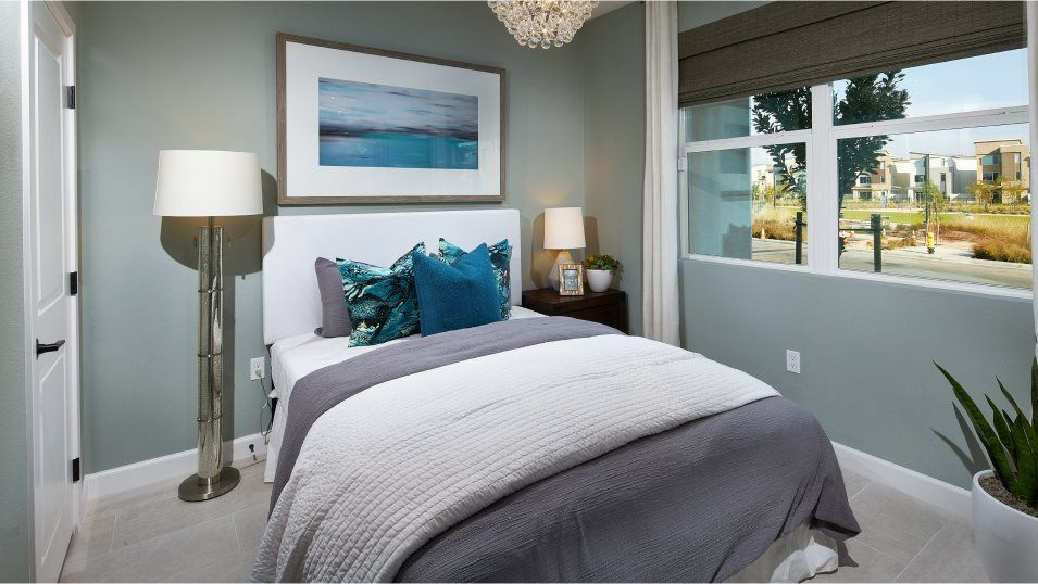 Millenia Vibe Residence 2 Bedroom 4:A first-level bedroom suite is ideal for overnight guests, a home office or older children who need
