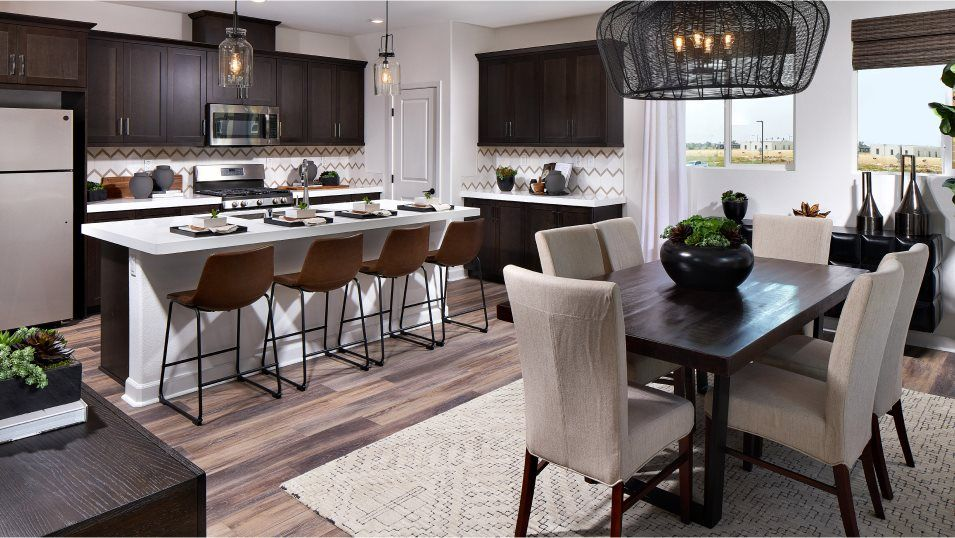 Millenia Vibe Residence 3 Kitchen:The contemporary kitchen features stainless steel appliances and versatile Shaker-style cabinetry, w