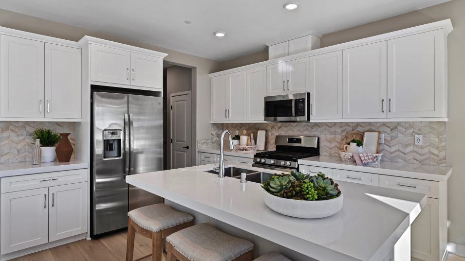 Canopy Grove Retreat Residence 2 Kitchen:This contemporary kitchen features plenty of storage space with designer-selected cabinetry, high-en